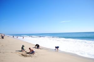 Kids playing on the beach, Pacific Ocean near San Francisco, California